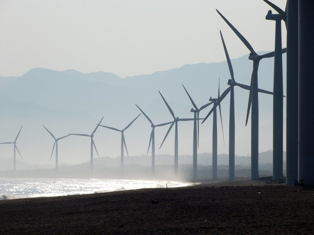 Close-up of wind turbines.  Sustainable Industrialization relies on technology like green energy.